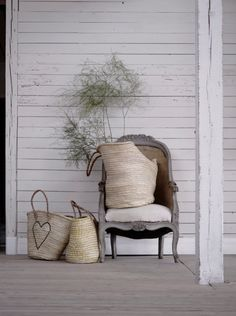 Sit down in a cosy chair on the pretty porch of the little white house........