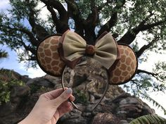 Be ready for your safari experience at Disneys Animal Kingdom or any of your favorite Disney parks with these awesome giraffe inspired Minnie/Mickey mouse ears