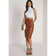 Missguided Faux Leather Midi Pencil Skirt Sexy faux leather midi length pencil skirt. Surprisingly versatile! Pair with a more conservative top and shoes for a chic work look, or rock a crop top and ski high stilettos to wow your date. Fun details include pockets, back slit, and notched waist. Never worn! The pics make it look wrinkled, but as soon as it's on and pulled taut, this completely goes away.   ?? US 6//UK 10 (main label marked UK) Missguided Skirts Midi