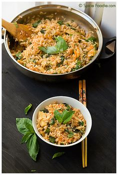 Thai curried fried rice. Recipe uses cooked rice. Spicy fried rice made with Thai curry. Lots of possible variations using other ingredients like chicken or shrimps.
