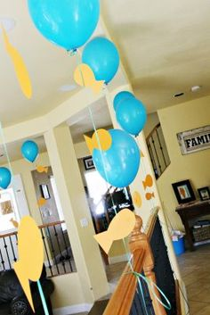 decor...easy dollar tree balloons and Moms cricket can cut out the fish any size you want! Glue on googley eye's or draw eye's on by hand.
