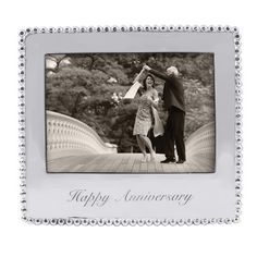 """Features:  -Statements collection.  Style (Old): -Contemporary.  Color: -Silver.  Material: -Metal.  Picture Size: -5"""" x 7"""".  Picture Capacity: -1.  Frame Type: -Table top.  Text: -Yes.  Orientation:"""