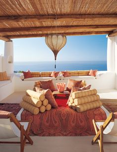 Moroccan inspired outdoor living area.  Oh yes, one day it will be mine.