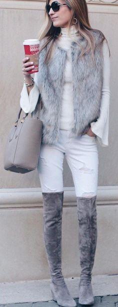 #winter #fashion / Grey Faux Fur Vest / White Turtleneck / Ripped Skinny Jeans / Grey OTK Velvet Boots