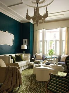 Seating placement, coffee table, crown moulding & ceiling & floor to ceiling curtains with nice curtain valance.  Faux bois, turquoise lacquer, and ivory