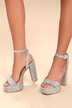 We're starstruck over the Estelle Silver Glitter Platform Ankle Strap Heels! Shimmering silver glitter covers these sky-high heels with a peep-toe upper, toe platform, and an adjustable ankle strap with covered buckle. Prom Shoes Silver, Silver Glitter Heels, Silver High Heels, Glitter Shoes, Silver Strappy Shoes, Silver Sparkly Heels, Glitter Face, Glittery Nails, Silver Pumps