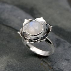Luminous Lotus Moonstone Ring    Natural rose cut rainbow moonstone is set in an opening lotus flower. Ive hand cut and layered sterling silver to