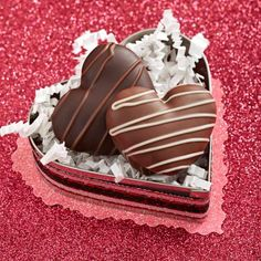 A heart-shape cookie cutter is just the right size to hold a couple of chocolate hearts. Details + more ideas for Valentine's Day: http://www.midwestliving.com/homes/seasonal-decorating/easy-valentines-day-decorations-and-gifts/