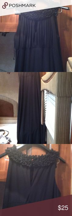 Formal dress Ruffled neck line completely around to the back. one button back.  Key hole just below ruffles on front.  Sleeveless.  Floor length. The back is shown in last picture. Onyx Dresses Strapless
