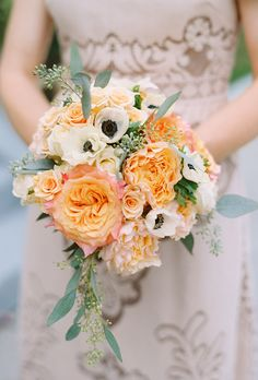 Bouquet of peach Juliet roses, white anemones, and pink roses.