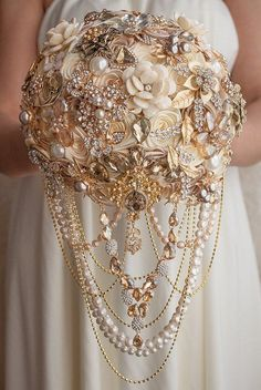 Draped Crystal and Pearl Bouquet - How To Incorporate Vintage Jewelry Into Your Bridal Look - Southernliving. Pull out all the stops—and necklaces and bracelets—to create this dramatic cascading bouquet. See the Pin Gold Bouquet, Broschen Bouquets, Hydrangea Bouquet Wedding, Wedding Brooch Bouquets, Cascade Bouquet, Wedding Flowers, Pearl Bouquet, Crystal Bouquet, Beach Flowers