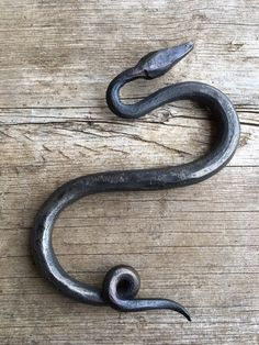 """These amazing little snakes have been hand forged out of steel and formed into a new twist on the traditional S hook. Use a whole line of them for a truly stunning chain or mix just one snake into a line of our big S hooks for a surprising detail. Being hand made they vary slightly in size coming in at 5.5""""-6.5"""" long and 3.5""""-4"""" wide Or use them in a totally different way as sculpture nestled in the garden or on a shelf. They have been coated with a traditional wax finish and can be…"""
