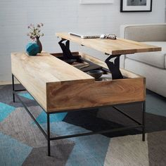 This is the Rustic Storage Coffee Table from West Elm. Multi-purpose furniture: table, storage, and desk.