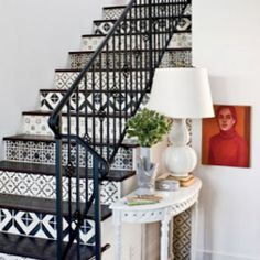 This site has various pictures of ideas for painting your stairs.  Might be fun to try on stairs leading down to basement!
