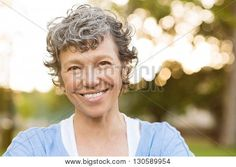 Image of Portrait of Senior Woman Relaxing at Park Close Up Face