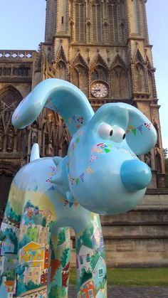 """Gromit Unleashed - Artist Paula Bowles chose to paint """"Bunty"""" Gromit as a 'street party' scene, adorned with colorful bunting, as she thought that he would enjoy a good party (& a cracking cup of tea!)."""