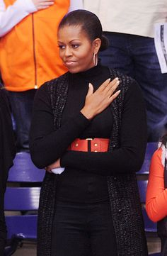A rare photo of the Mooch with her hand over her heart... But the sour look on her face proves she did it grudgingly...