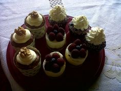 Carrot cupcake, chocolate with cherry cupcake, and mini cheese cake with raspberries. Delicious! :)