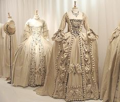 Wedding dresses - 18th century style. Keira Knightley wore the one with bows in The Duchess. The embroidered dress was for Helena Bonham-Carter in Frankenstein. Skirts over panniers or side hoops.