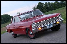 1966 Chevrolet Chevy II   This is EXACTLY how I want to finish my 1966 chevy II. red on red, with red wheels and centercaps.
