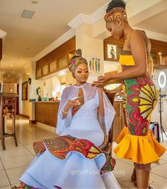 Image may contain: one or more people and people standing African Fashion Skirts, African Print Fashion, Africa Fashion, African Clothes, Unique Ankara Styles, Latest Aso Ebi Styles, Zulu Traditional Wedding Dresses, Wedding Dresses For Curvy Women, African Bridesmaid Dresses