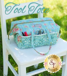 "Tool Tote Pattern Tool Tote is what everyone needs and wants!  Pockets all the way around on the outside, pockets all the way around on the inside!  Heavy duty formed metal stays that keep the bags mouth wide open, easy to get in and reach all your important tools. There are many uses for this versatile tote. Designed by Penny Sturges featuring fabrics from the Welcome Home Collection One! 15"" long x 10"" wide x 7"" tall."