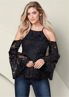 """LACE BELL SLEEVE TOP More sensuous than sexy, this lace bell sleeve top allows your gentle femininity to shine. The intricate lace, sheer sleeves, and graceful peplum combine to present a charming you! Body is lined, sleeves are not Center back invisible zipper Bell sleeve Cold shoulder Allover lace Scalloped detail at bottom edge Approx. 25"""" in length; varies by size"""