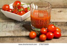 tomato juice with tomato bunch