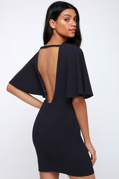 They'll make a toast to chic style in the Lulus Here's to You Navy Blue Backless Dress! A rounded neckline, and trendy wide, cape sleeves, made from textured stretch knit, top a relaxed bodice. Fitted waist and figure-skimming sheath skirt with seaming. Plunging open back. Free shipping and returns!