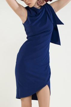 https://www.cityblis.com/8131/item/15058  Style: 124 Rosemary Dress - $508 by NICO DIDONNA  The cobalt blue dress ensures a casual feminine look. Fabric Drapes softly over one sleeve. Ideal for an evening party.  Also available in scarlet red please call in store to make order  Material: Mixed Fiber Fitted to body • Asymmetric bottom hem  • Fabric drapes around one sleeve • Made...