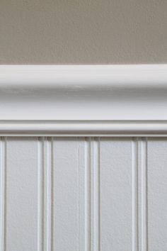 Beadboard wallpaper is the bomb! Add molding, paint it, it's gorgeous. The end!