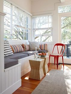 This stylish window seat offers extra storage in this kitchen. More creative ideas for window seats: http://www.bhg.com/home-improvement/windows/built-in-window-seat/?socsrc=bhgpin082613redchair