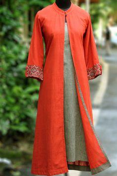 a stunning ensemble in soft flowy saffron orangekhadi and a…