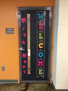 Black and neon classroom door