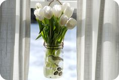 Even the kids can help make these pretty hanging vases from glass jars. Get the how to over at GardenMama — Hanging Window Vase Tutorial. Hanging Mason Jars, Mason Jar Vases, Glass Jars, Pot Mason Diy, Pots, White Tulips, Flower Vases, Hanging Flowers, Diy Flower