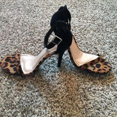 Cheetah print black heels Cheetah print black heels, never worn Shoes Heels
