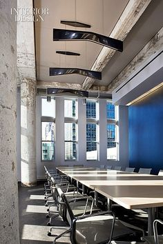 Fire, Air, Water: An Historic Chicago Factory Turned Futuristic Whirlpool Showroom. The clock tower houses the boardroom, with its tabletop veneered in ash. #office