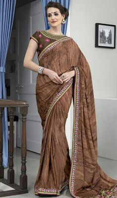 Give yourself a refreshing new look dressed in this brown color crepe silk and raw silk sari. This wonderful attire is displaying some great embroidery done with lace and resham work. #georgettesarees #womensaris2015 #browncolorsaree