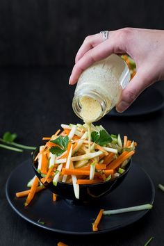 French Carrot and Apple Salad - Bite into a bowl of healthy happy feels with this French Apple and Carrot Salad Bursting with juicy goodness from apples carrots and fresh cilantro it s deliciously easy to whip up as a quick snack or summery side dish Giada De Laurentiis, Vegetable Salad, Vegetable Dishes, Vegetarian Recipes, Cooking Recipes, Healthy Recipes, Healthy Meals, Healthy Food, Carrot Slaw