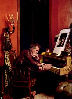 Keith Richards in his room dedicated to music in his home in Connecticut with a picture of Charlie Watts and of his grandson Orson, 2002. © Photo by Deborah Feingold.