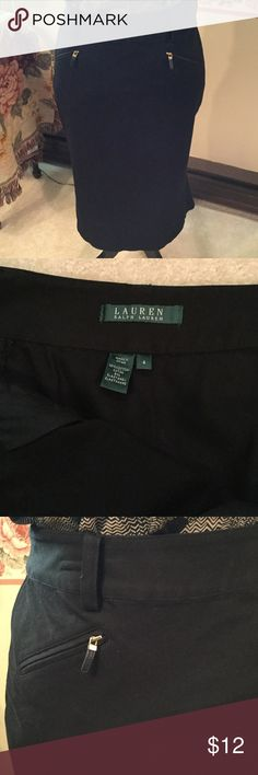 🎉🎉NEW PRICE🎉🎉Lauren Ralph Lauren Skirt Ralph Lauren black stretch skirt in size 4. Fitted waist, zipper pockets in front and a peblum look on the hem on the back of skirt.  See photo 4.  Length is 27 inches.  Blouse or necklace not included. Lauren Ralph Lauren Skirts Midi