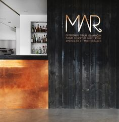 Mar Restaurant in Reykjavik, Iceland   Remodelista Great combo - copper and black wood.
