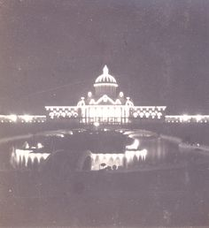 Cotton Palace and Sunken Gardens at the South Carolina Inter-State and West Indian Exposition, taken at night showing the electric lights, circa 1901. Charleston Museum
