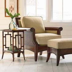 This carved wood frame features clean scrolled arms, woven inserts and flared tapered legs. The boxed back cushions are slightly sheltered by the wood framed back panel.