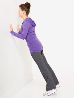 Wall Push-Ups   Stand about 3 feet away from a wall and lean forward, placing your hands shoulder-width apart against the wall. Bend your elbows and bring your chest toward the wall (your heels may come off the floor), then push away until your arms are straight again. Repeat 10 times.  TONES: Chest muscles, to keep your upper body lifted