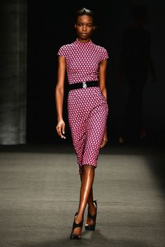 A model walks the runway at the Monique Lhuillier fashion show during Mercedes-Benz Fashion Week Fall 2014 at The Theatre at Lincoln Center ...