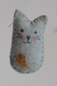 Felt Cat - glue together, then sew around edges. ornament, book marker, birds, cats, dogs, etc.