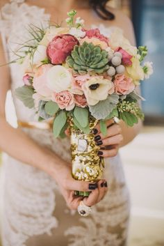 peony, anemone, air plant, succulent bouquet, photo by Suzuran Photography http://ruffledblog.com/new-years-eve-cleveland-wedding #flowers #weddingbouquet