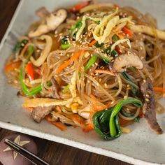 (Korean Stir Fried Noodles) 잡채 Japchae 잡채 (Korean Stir Fried Noodles) - Have you tried Japchae (Korean sweet potato noodles stir fried with vegetables and meat)? This recipe will show you how easy it is to cook up this beloved Korean noodle dish at home! Korean Sweet Potato Noodles, Korean Noodles, Stir Fry Noodles, Japanese Noodles, Ramen Noodles Recipe, Japchae Noodles, Korean Potatoes, Filipino Noodles, Garlic Noodles Recipe