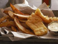 Fish & Chips in newspaper - YUM!! This is how we had fish and chips when I was young.